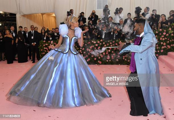 TOPSHOT Zendaya and Law Roach arrive for the 2019 Met Gala at the Metropolitan Museum of Art on May 6 in New York The Gala raises money for the...
