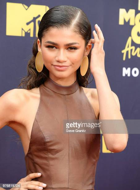 Zendaya arrives at the 2018 MTV Movie And TV Awards at Barker Hangar on June 16 2018 in Santa Monica California
