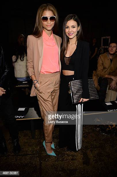 Zendaya Coleman and Victoria Justice attend the DKNY Women's fashion show during MercedesBenz Fashion Week Fall 2014 on February 9 2014 in New York...
