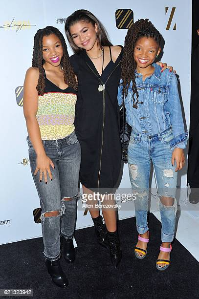 Zendaya poses for a picture with recording artists Halle Bailey and Chloe Bailey of Chloe X during the Daya By Zendaya Pop-up Shop event at Known...