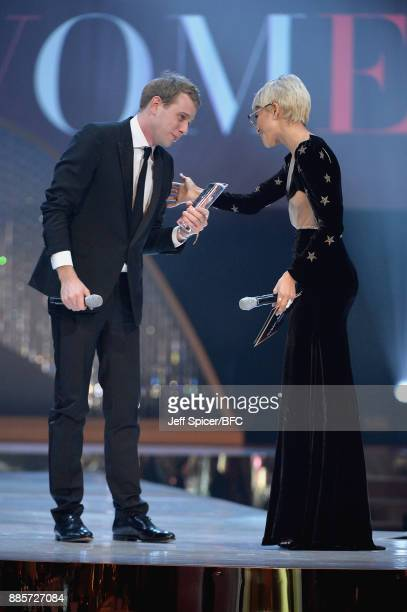 Zendaya presents Jonathan Anderson with the British Designer of the Year Womenswear award on stage during The Fashion Awards 2017 in partnership with...