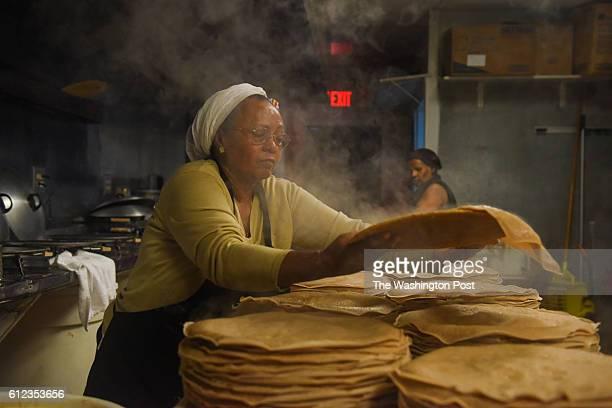 Zenebech Dessu prepares injera an East African sourdoughrisen flatbread at her Zenebech Restaurant a popular Ethiopian eatery beloved by Ethiopians...