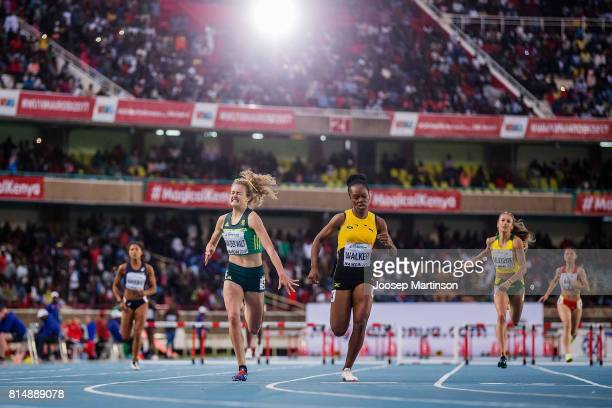 Zener van der Walt of South Africa competes with Sanique Walker of Jamaica in the girls 400m hurdles during day 4 of the IAAF U18 World Championships...