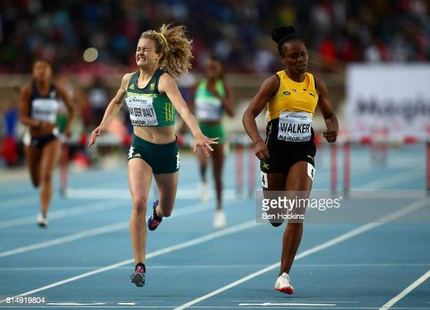 Zeney Van Der Walt of South Africa dips for the finish line ahead of Sanique Walker of Jamaica to win gold in the final of the girls 400m hurdles on...