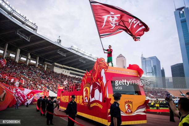Zeng Cheng of Guangzhou Evergrande waves a flag during the Champion Award Ceremony for 2017 Chinese Football Association Super League on November 4...
