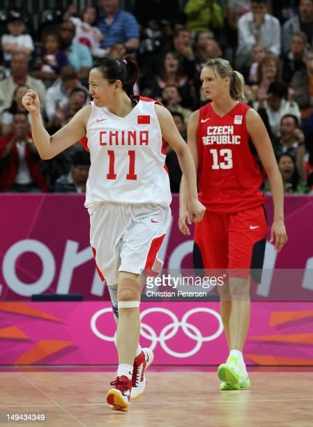 Zengyu Ma of China celebrates as Petra Kulichova of Czech Republic looks on during Women's Basketball on Day 1 of the London 2012 Olympic Games at...
