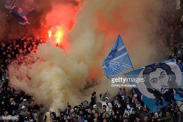Zenit Saint Petersburg fans light flares during the Russian Football League Championship match between Spartak Moscow and Zenit at the Luzhniki...