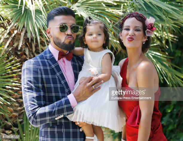 Part of this image has been pixellated to obscure the identity of the child Zenit Saint Petersburg Football player Ezequiel Garay her wife Tamara...