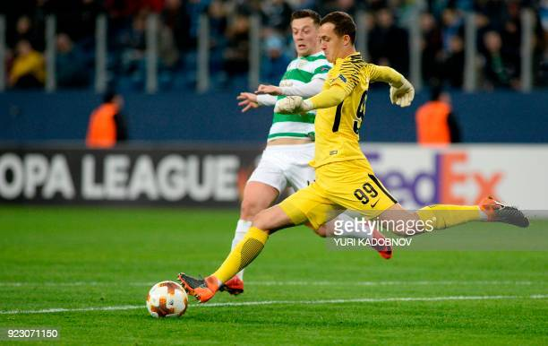 Zenit Saint Petersburg's goalkeeper from Russia Andrey Lunev vies with Celtic's Scottish midfielder Callum McGregor during the Europa League Round of...