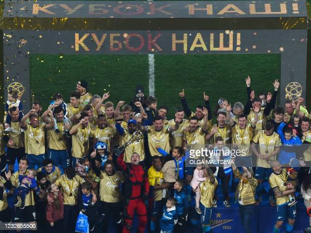 Zenit Saint Petersburg's players celebrate at Krestovsky Stadium in Saint Petersburg, on May 2 after the team won the Russian Premier League title. -...