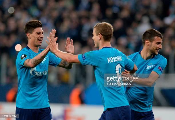 Zenit Saint Petersburg's players celebrate their goal during the Europa League Round of 32 second leg football match between Zenit Saint Petersburg...