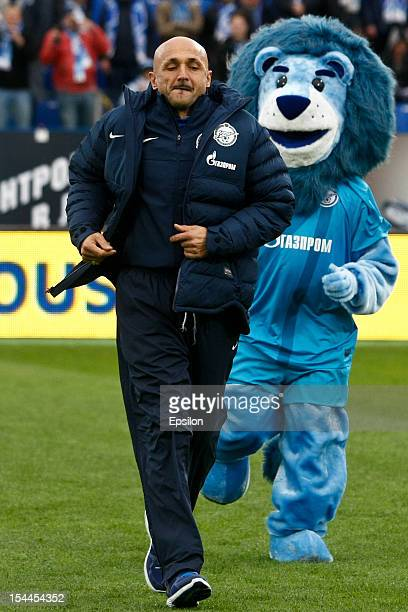 Zenit St Petersburg head coach Luciano Spalletti runs across the pitch along with FC Zenit St Petersburg mascot during the Russian Football League...