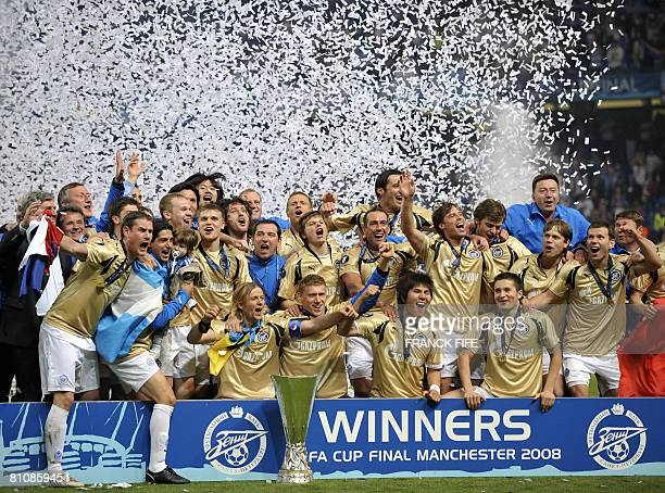 Zenit St Petersburg players celebrate with the trophy after the UEFA Cup final match between Scottish football club Glasgow Rangers and Russian side...