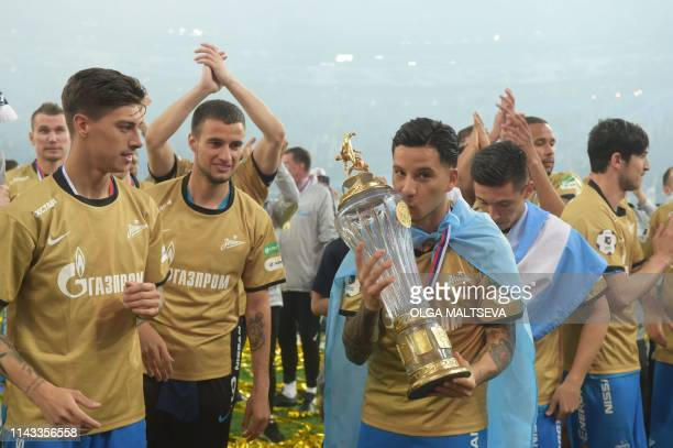 Zenit St Petersburg Spanish defender Sebastian Driussi kisses a trophy as they celebrate a victory of 2018/19 Russian Premier League after the Round...