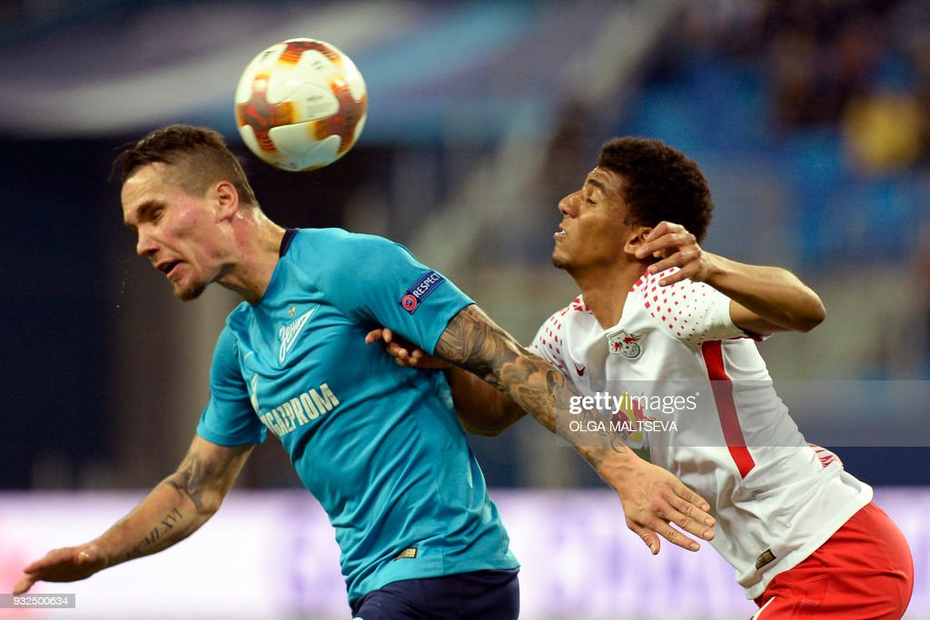 Zenit St. Petersburg's Anton Zabolotny (L) and Leipzig's Brazilian defender Bernardo vie for the ball during the UEFA Europa League Round of 16 second leg football match between FC Zenit and RB Leipzig on March 15, 2018 in Saint Petersburg. / AFP PHOTO / Olga MALTSEVA