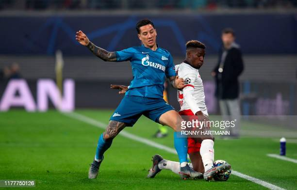 Zenit St Petersburg's Argentine forward Sebastian Driussi and Leipzig's French defender Nordi Mukiele vie for the ball during the UEFA Champions...