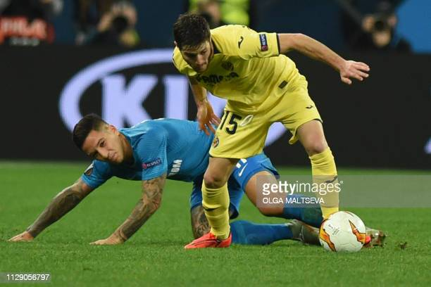Zenit St Petersburg's Argentine forward Sebastian Driussi and Villarreal's Spanish defender Miguelon vie for the ball during the Europa League round...