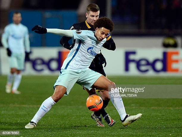 Zenit St Petersburg's Belgian midfielder Axel Witsel and Dundalk's Irish midfielder Patrick McEleney vie for the ball during the UEFA Europa League...