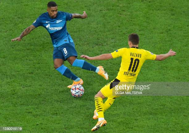 Zenit St. Petersburg's Brazilian forward Malcom and Borussia Dortmund's Belgian midfielder Thorgan Hazard vie for the ball during the UEFA Champions...