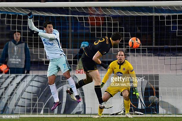 Zenit St Petersburg's Brazilian midfielder Giuliano and Dundalk's Irish defender Brian Gartland vie for the ball next to Dundalk's Irish goalkeeper...