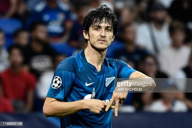 Zenit St Petersburg's Iranian forward Sardar Azmoun celebrates after scoring a goal during the European Champions League football match between...