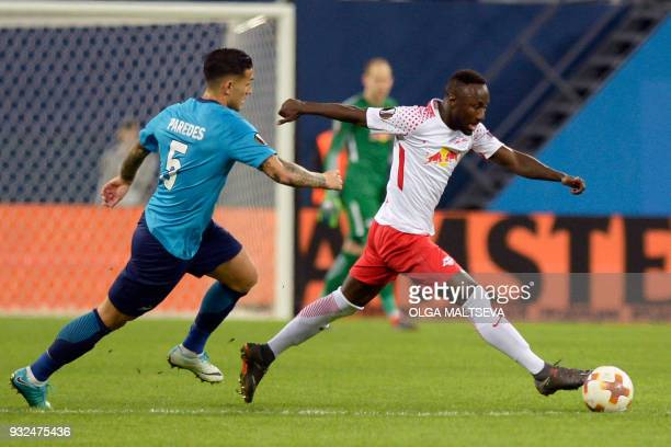 Zenit St Petersburg's midfielder from Argentina Leandro Paredes and Leipzig's Guinean midfielder Naby Keita vie for the ball during the UEFA Europa...
