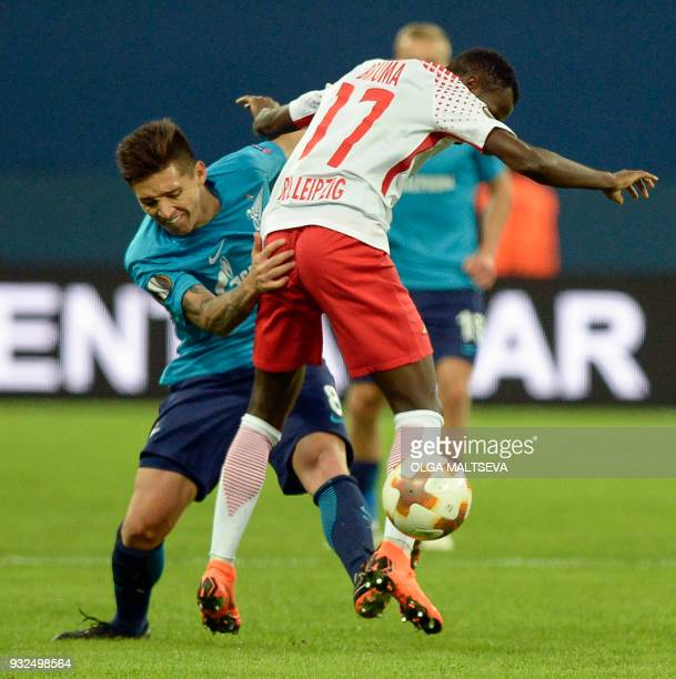 Zenit St Petersburg's midfielder from Argentina Matias Kranevitter and Leipzig's Portuguese midfielder Bruma vie for the ball during the UEFA Europa...