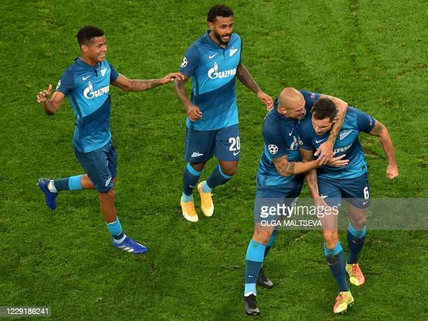 Zenit St Petersburg's players celebrate after scoring a goal during the UEFA Champions League Group F football match between Zenit St Petersburg and...