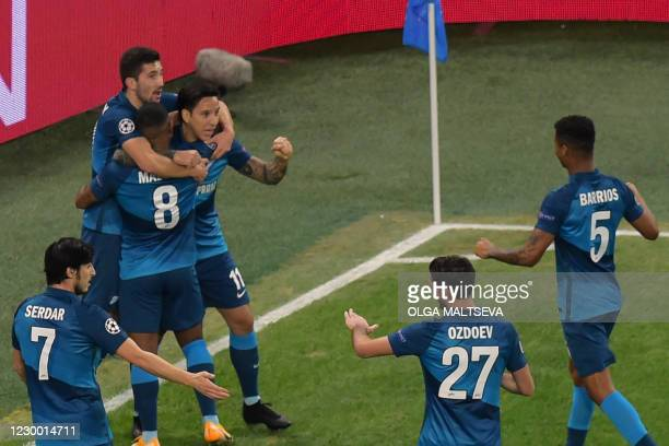 Zenit St. Petersburg's players celebrate the opening goal scored by Argentinian forward Sebastian Driussi during the UEFA Champions League football...