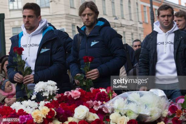 Zenit St Petersburg's Róbert Mak, Anatoliy Tymoshchuk and Alexandr Kerzhakov pay tribute to victims of the St Petersburg Metro explosion at an...