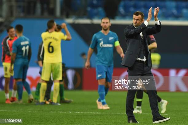 Zenit St Petersburg's Russian coach Sergey Semak thanks supporters after the Europa League round of 16 first leg football match between FC Zenit and...