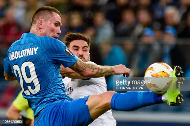 Zenit St Petersburg's Russian forward Anton Zabolotny and FC Copenhagen's Swedish defender Sotirios Papagiannopoulos vie for the ball during the UEFA...
