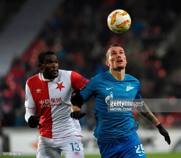 Zenit St Petersburg's Russian forward Anton Zabolotny and Slavia Prague's Cameroon defender Michael NgadeuNgadjui vie for the ball during the UEFA...
