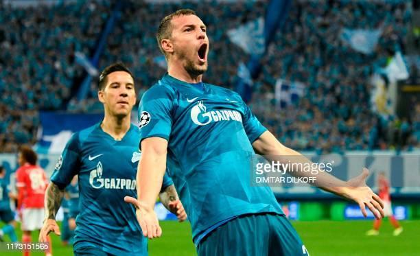 Zenit St. Petersburg's Russian forward Artem Dzyuba celebrates with Zenit St. Petersburg's Argentine forward Sebastian Driussi after scoring a goal...