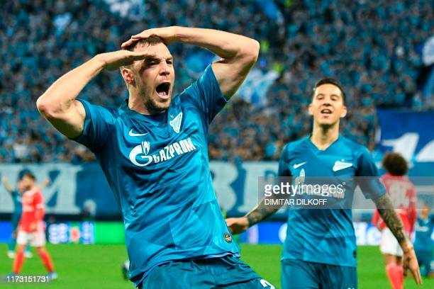 TOPSHOT Zenit St Petersburg's Russian forward Artem Dzyuba celebrates with Zenit St Petersburg's Argentine forward Sebastian Driussi after scoring a...