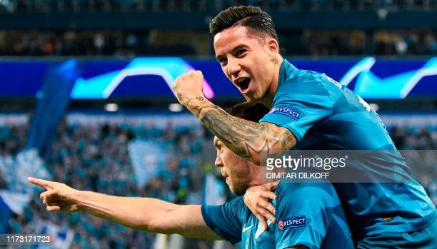 Zenit St Petersburg's Russian forward Artem Dzyuba celebrates with Zenit St Petersburg's Argentine forward Sebastian Driussi after scoring a goal...