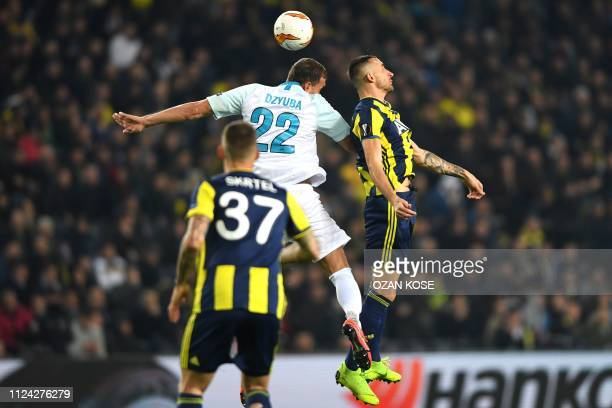 Zenit St Petersburg's Russian forward Artem Dzyuba fights for the ball with Fenerbahce's Slovak defender Martin Skrtel and Fenerbahce's Turkish...