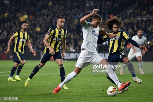 Zenit St Petersburg's Russian forward Artem Dzyuba fights for the ball with Fenerbahce's Turkish defender Sadik Ciftpinar during the UEFA Europa...