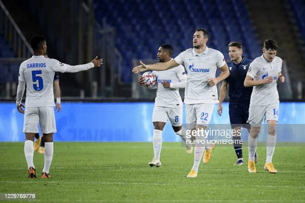 Zenit St. Petersburg's Russian forward Artem Dzyuba is congratulated by teammates after scoring a goal during the UEFA Champions League Group F...