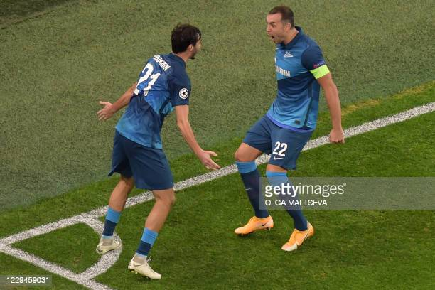 Zenit St. Petersburg's Russian midfielder Aleksandr Erokhin celebrates with teammates after scoring the opening goal during the UEFA Champions League...
