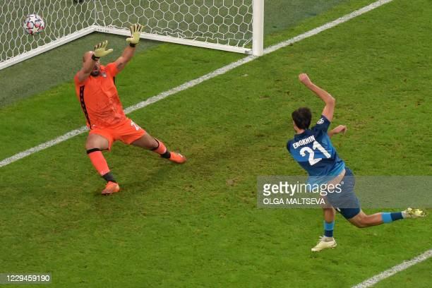 Zenit St. Petersburg's Russian midfielder Aleksandr Erokhin scores the opening goal during the UEFA Champions League football match between Zenit and...