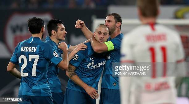 Zenit St Petersburg's Ukrainian defender Yaroslav Rakitskiy is congratulated by teammates after scoring the 01 during the UEFA Champions League Group...