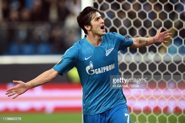 Zenit StPetersburg's Iranian forward Sardar Azmoun celebrates after scoring the team's third goal during the UEFA Europa League round of 32 second...