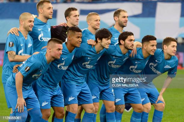 Zenit StPetersburg's players pose before the Europa League round of 16 first leg football match between FC Zenit and Villarreal CF in Saint...