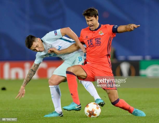 Zenit's Argentinian midfielder Matias Kranevitter challenges Real Sociedad's Spanish midfielder Xabier Prieto during the UEFA Europa League group L...