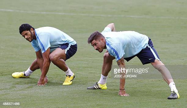 Zenit's Brazilian forward Hulk and Zenit's Spanish midfielder Javi Garcia stretch during a trainning session at the Mestalla Stadium in Valencia on...
