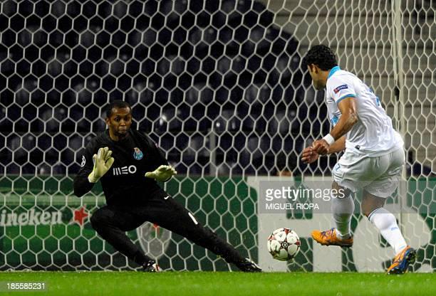 Zenit's Brazilian forward Hulk tries to score past Porto's Brazilian goalkeeper Helton Aruda during the UEFA Champions League Group G football match...