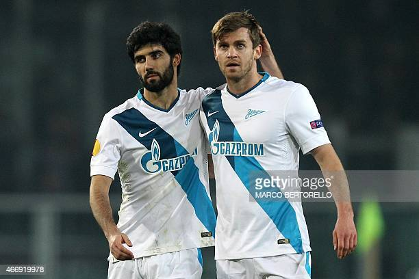 Zenit's defender Luis Neto of Portugal and Zenit's Belgian defender Nicolas Lombaerts react at the end of the UEFA Europa League round of 16 football...
