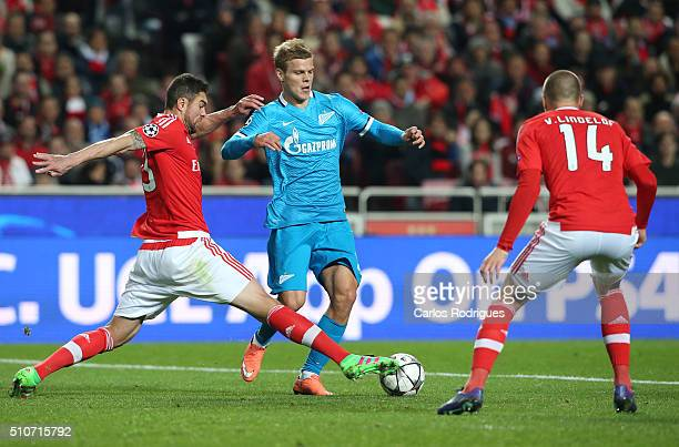 Zenit's forward Aleksandr Kokorin with SL Benfica's defender from Brazil Jardel in action during the UEFA Champions League Round of 16 First Leg...
