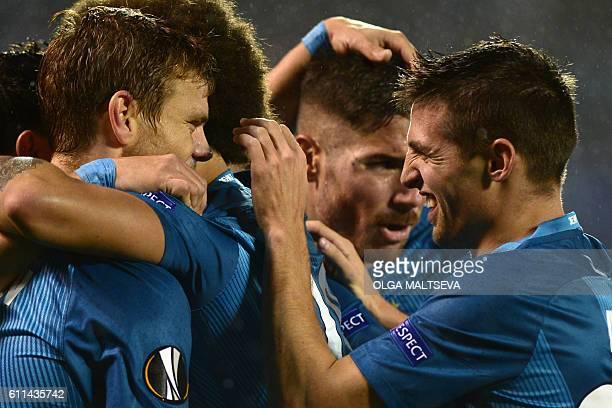 Zenit's forward Aleksandr Kokorin , Zenit's Spanish midfielder Javi Garcia and Zenit's Slovakian midfielder Robert Mak celebrate scoring a goal...
